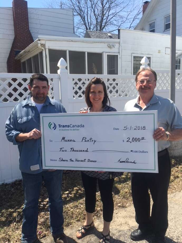 (From left) Tim Haney, of Transcanada, presents the Share the Harvest sponsorship check to Jody Gardei, of Manna Pantry, with the assistance of Larry London, of Transcanada. (Courtesy photo)