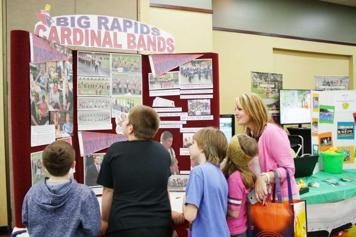 Students crowd around a display for Big Rapids bands at the 2016 Philanthropy Day event. This year, the event has been renamed Community Giving Day and will take place Nov. 2 in the Miller Wing of the Mecosta-Osceola Career Center. (Pioneer file photo)