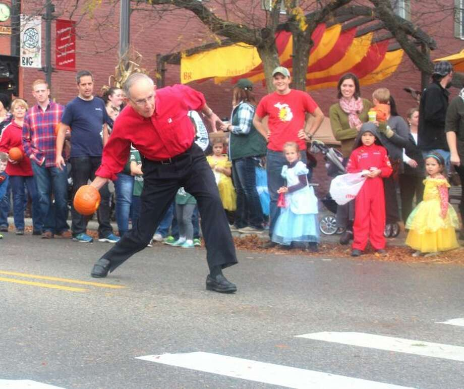 Ferris State University President David Eisler prepares to release his pumpkin in the 2016 Celebrity Pumpkin Roll during Fall Festival. (Pioneer file photo)