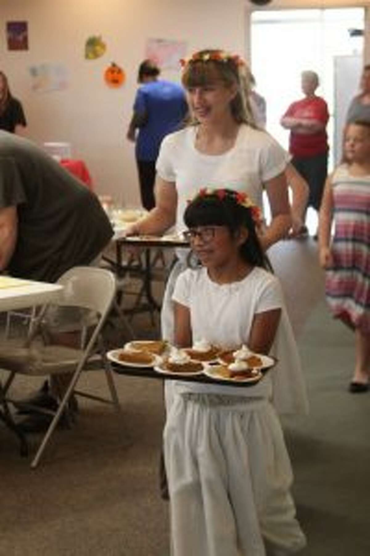 Fifth- through eighth-grade students at Trinity Lutheran Church and School help serve dessert during Saturday's Harvestfest Dinner. The annual fundraiser has taken place for more than 20 years, and helps the school's Parent-Teacher League provide funds and support for school programs.
