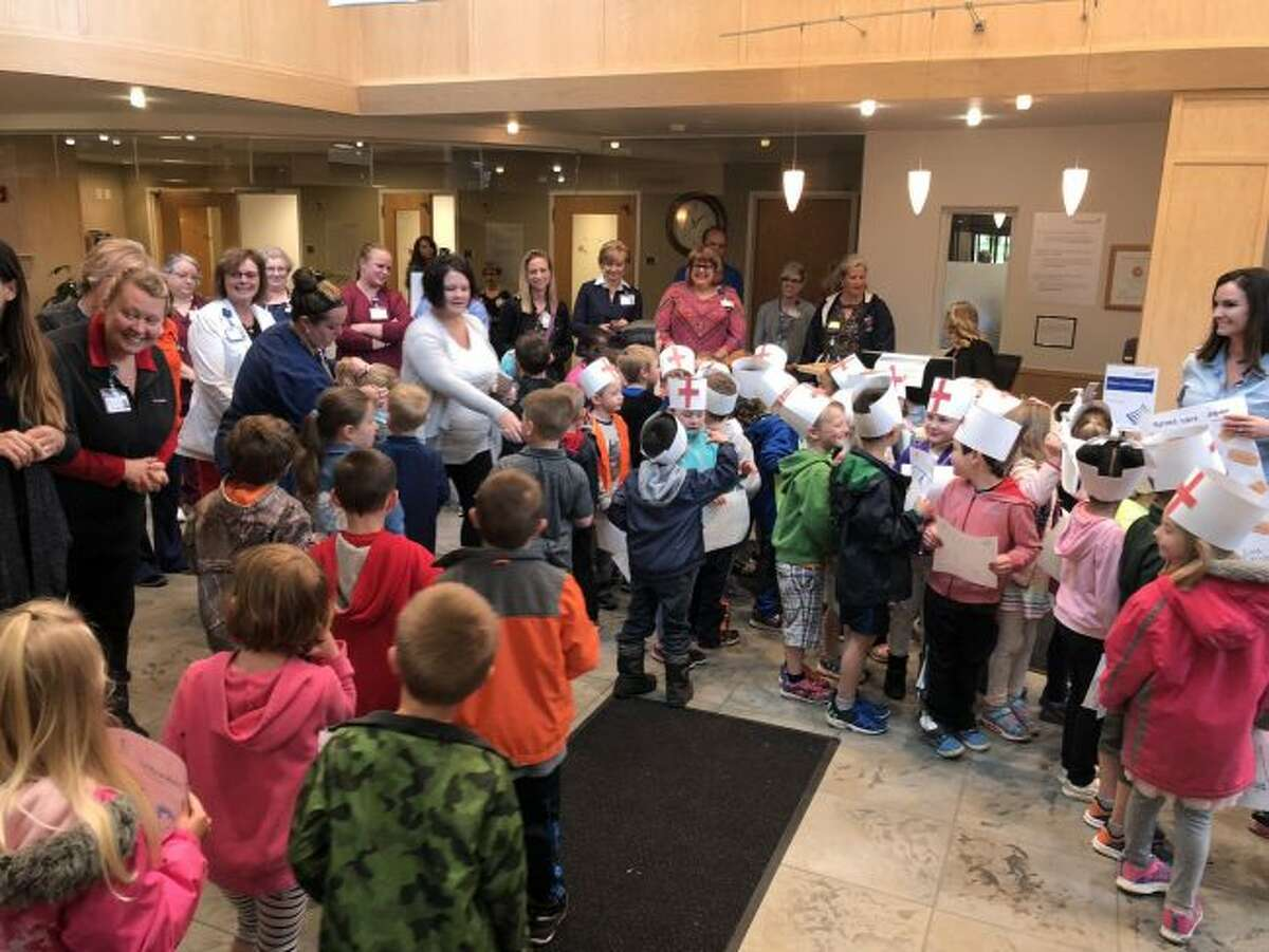 Thursday morning, students from all four Riverview Elementary kindergarten classes walked to neighboring Spectrum Health Big Rapids Hospital to honor nurses during National Nurses Week. (Courtesy photo)