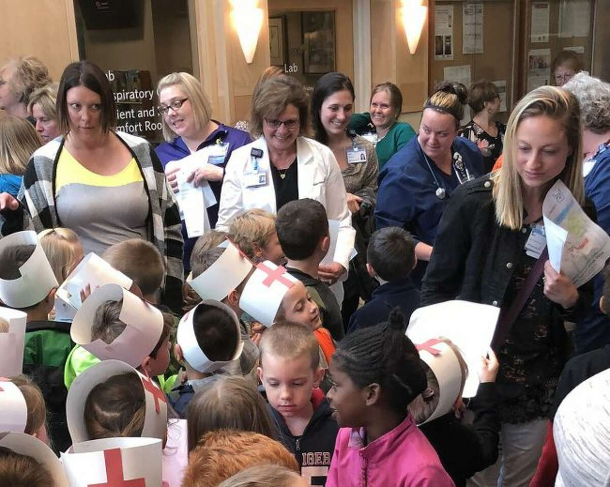 Caroline Ring, chief nursing officer for Big Rapids and Reed City Hospitals (center), greets kindergartners. (Courtesy photo)