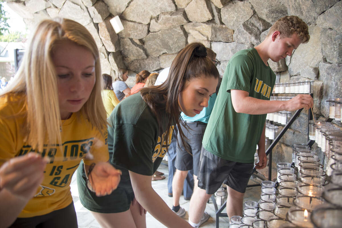 Students light candles during Siena College prayer service for college President Brother Ed Coughlin on Friday, July 26, 2019 in Loudonville, N.Y.