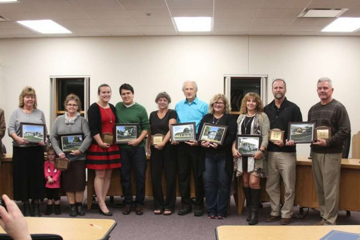 Recipients of the Good Neighbor Association's Pride of the Neighborhood Awards are recognized Monday during the annual presentation of the awards. The awardees included the Mecosta County Area Chamber of Commerce and Convention and Visitors Bureau, Kyle Smoes, Sherrill Phillion, Thomas and Katie Dash, Randy and Cheryl Stein, Thomas and Katie Derrick, Michele Sullivan, Melissa Jensen, Amy Metz and Alice McKenna. (Pioneer photo/Brandon Fountain)