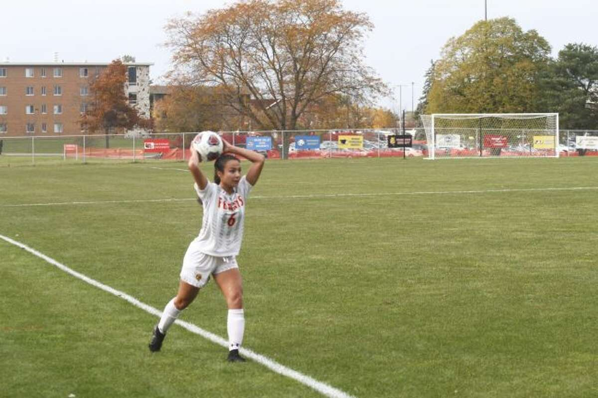 Ferris State defender Tia VanSuilichem throws in the ball during Tuesday's GLIAC Tournament quarterfinal game. (Pioneer photo/Maxwell Harden)