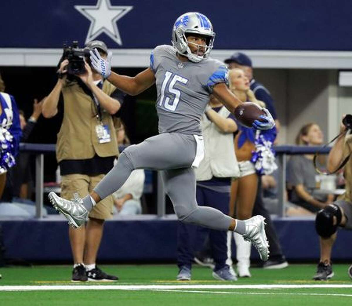 Lions wide receiver Golden Tate looks over his shoulder on a touchdown run on a pass from Matthew Stafford in the first half in Arlington, Texas, Sunday, Sept. 30, 2018. Eric Gay, AP