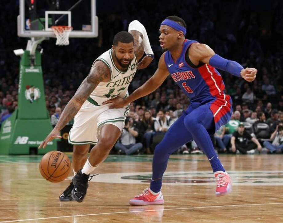 Boston Celtics forward Marcus Morris (13) drives against Detroit Pistons guard Bruce Brown (6) during the first half of an NBA basketball game, Tuesday, Oct. 30, 2018, in Boston. (AP Photo/Mary Schwalm)