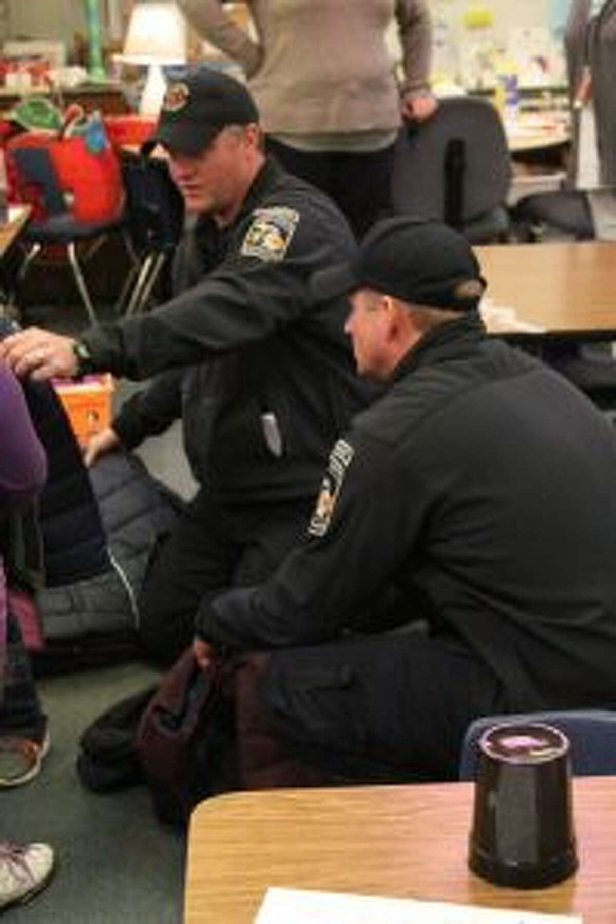 Big Rapids firefighters Russ Bell (left) and Sean Wethington help deliver winter apparel for kids at Brookside Elementary on Wednesday morning. Big Rapids firefighters' unions generated more than $1,200 for the coats, hats, scarves, gloves and snow pants.