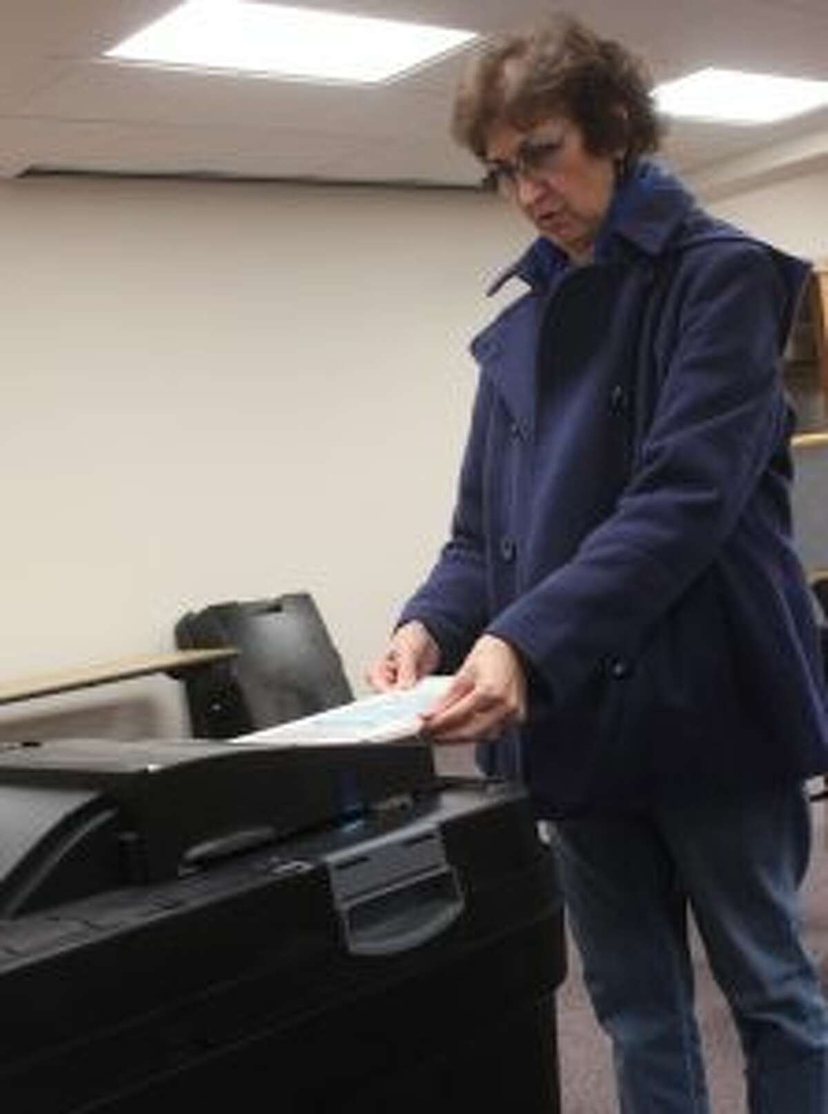 Jennifer Cochran casts her sample ballot during an open house on Wednesday at Big Rapids City Hall. Hosted by City Clerk Tammy Gillis, the open house aimed to familiarize city and area voters with the new Dominion Voting election machines. (Pioneer photo/Brandon Fountain)