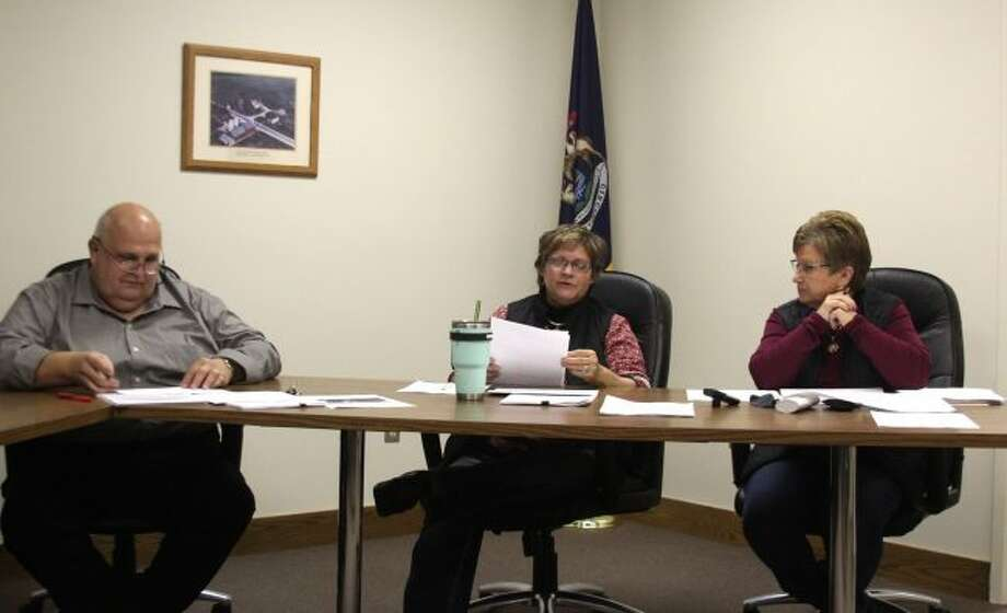 (From left to right) Big Rapids Charter Township Supervisor Bill Stanek, Treasurer Penny Currie and Clerk Rene Fountain have a discussion during a special meeting on Wednesday night. Township officials approved a wastewater treatment agreement between the City of Big Rapids, Big Rapids Township and Green Township. (Pioneer photo/Brandon Fountain)