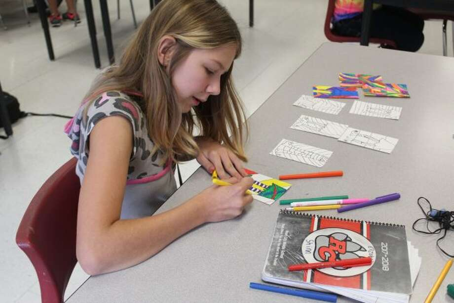 Reed City Middle School students work on their Art Club project on Thursday afternoon. The club meets about twice a month, and interested students are able to learn about different mediums of art throughout the school year. (Pioneer photo/Brandon Fountain)