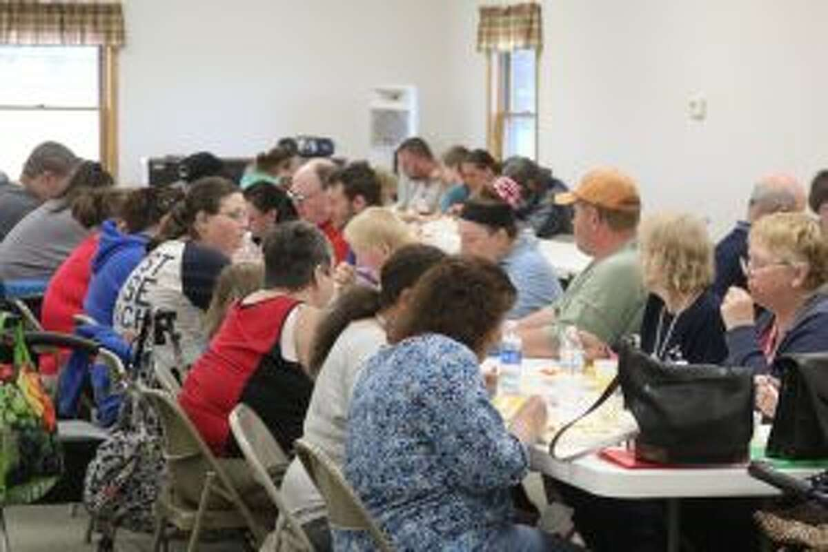 DINNER: A volunteer dinner greets participants, volunteers and instructors at Thursday's final class night for the Higher Ground Learning Center at the Evart Free Methodist Church. The session included classes for adults and children over eight weeks.