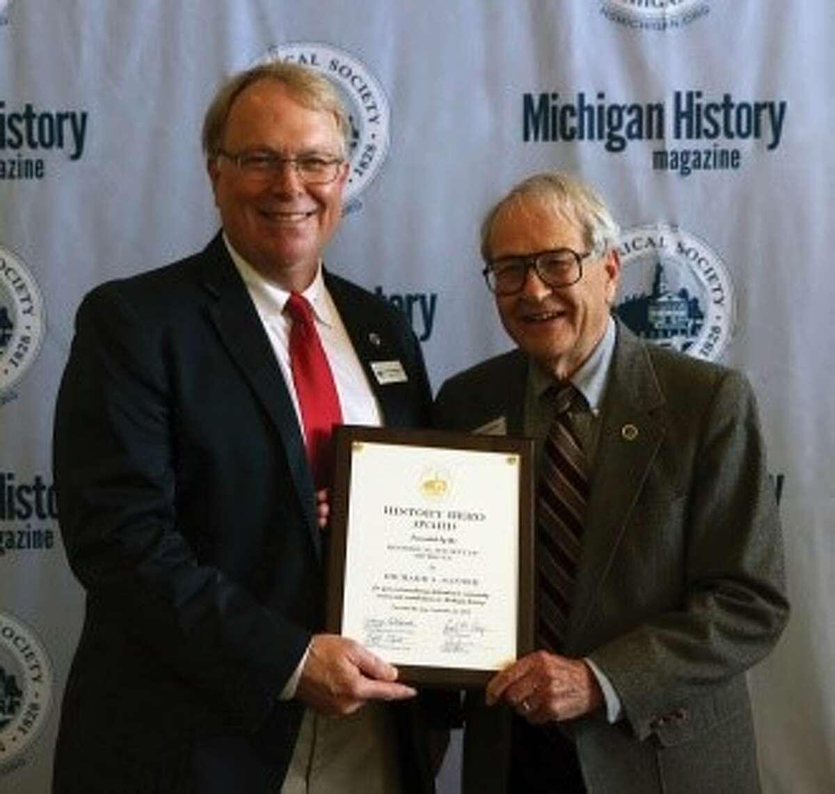 Ferris State University geology professor emeritus Richard Santer (right) received the History Hero Award from the Historical Society of Michigan during its annual meeting and conference in Sturgis. Pictured with Santer is Kendall Wingrove, a member of the Historical Society of Michigan board and awards committee chair. (Courtesy photo)