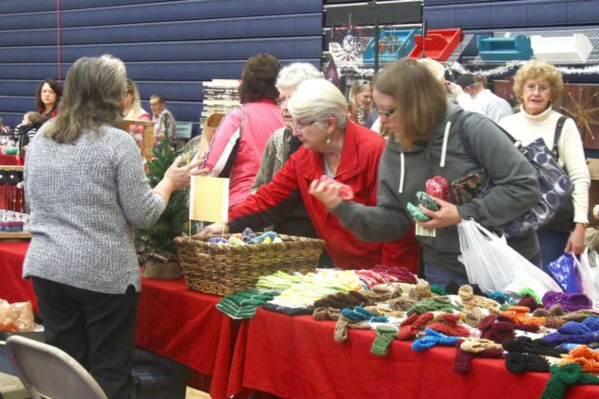 Shoppers at the 2016 Morley Stanwood Holiday Bazaar peruse a booth filled with household goods, including scrubbies and hand towels. This year's event will be from 10 a.m. to 3 p.m. on Saturday, Nov. 4, at the high school. (Pioneer file photo)