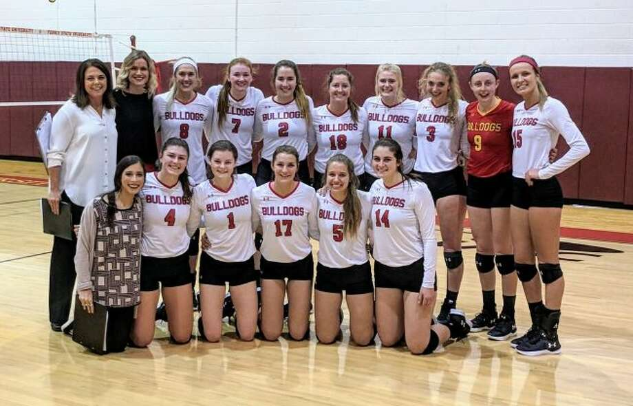 The Ferris State women's volleyball team poses after winning its fifth-consecutive GLIAC regular season title on Friday. (Pioneer photo/Maxwell Harden)