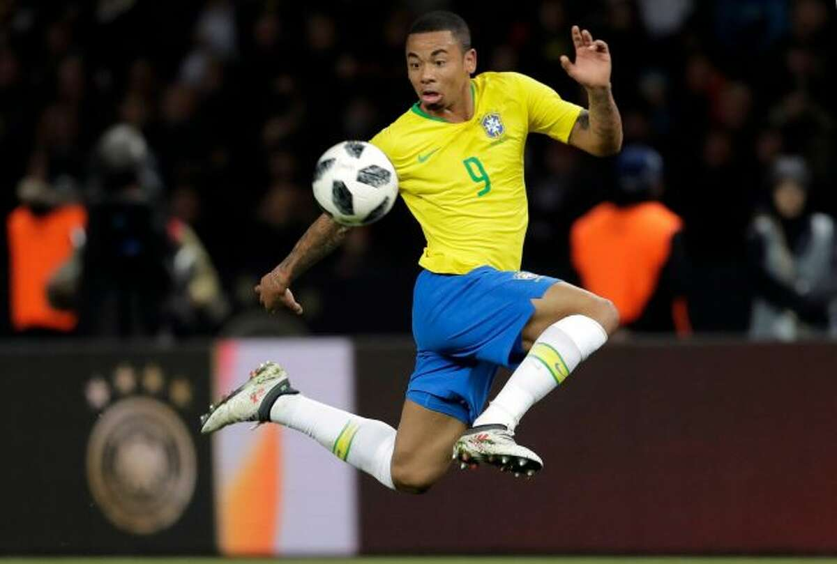Brazil's Gabriel Jesus controls the ball during the international friendly soccer match between Germany and Brazil in Berlin. At the World Cup four years ago, Colombia forward James Rodriguez became one of the stars of the tournament and shot to international fame with his trickery on the ball and eye for a spectacular goal. Here's a look at young players hoping to make a similar impact at this year's World Cup in Russia. Among them is France left back Benjamin Mendy, Spain midfielder Marco Asensio, Belgium winger Leroy Sane, and Brazil striker Gabriel Jesus. (AP Photo/Markus Schreiber)