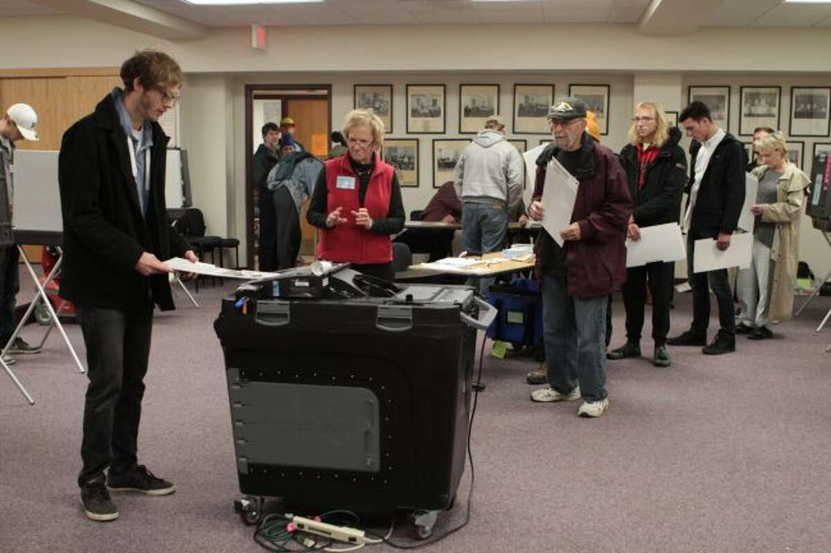 The polling booths at Big Rapids City Hall were busy on Tuesday as hundreds of city residents cast their vote in the general election. Officials throughout Mecosta and Osceola counties reported seeing a high voter turnout throughout the day. (Pioneer photos/Taylor Fussman)