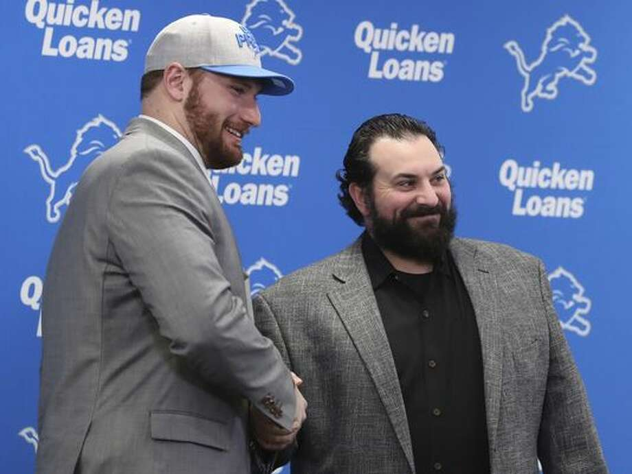 The Detroit Lions first-round NFL football draft pick Frank Ragnow, left, stands with head coach Matt Patricia at the team's training facility, Friday, April 27, 2018, in Allen Park, Mich. (AP Photo/Carlos Osorio)