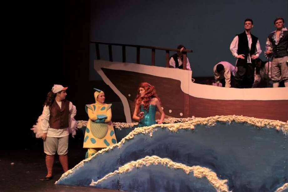 """Cast members prepare for their upcoming performances of """"The Little Mermaid,"""" which is set to run from Thursday through Saturday. The play will follow the Disney adaptation of the Hans Christian Anderson tale. (Pioneer photos/Meghan Gunther-Haas)"""