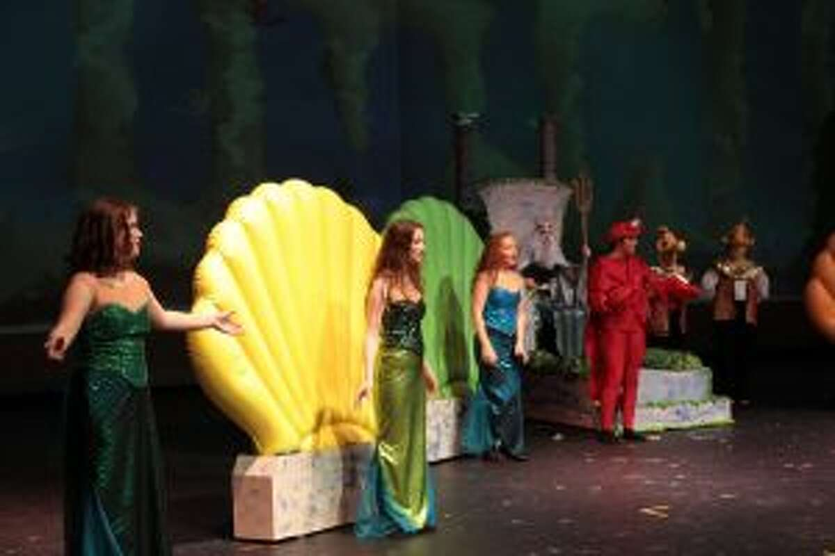 Mersisters sing under the direction of Sebationa, portrayed by Harley Samuels. During their song, Aquata, Andrina, Arista, Atina, Adella and Allana introduce their youngest sister, Ariel.
