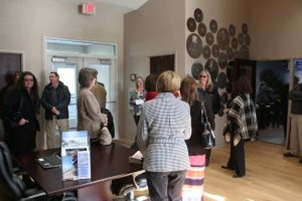 Dozens of community, business and government leaders arrive to look inside the new Mecosta County Welcome Center on Wednesday. The new building houses offices for the Mecosta County Area Chamber of Commerce and Mecosta County Convention and Visitors Bureau.