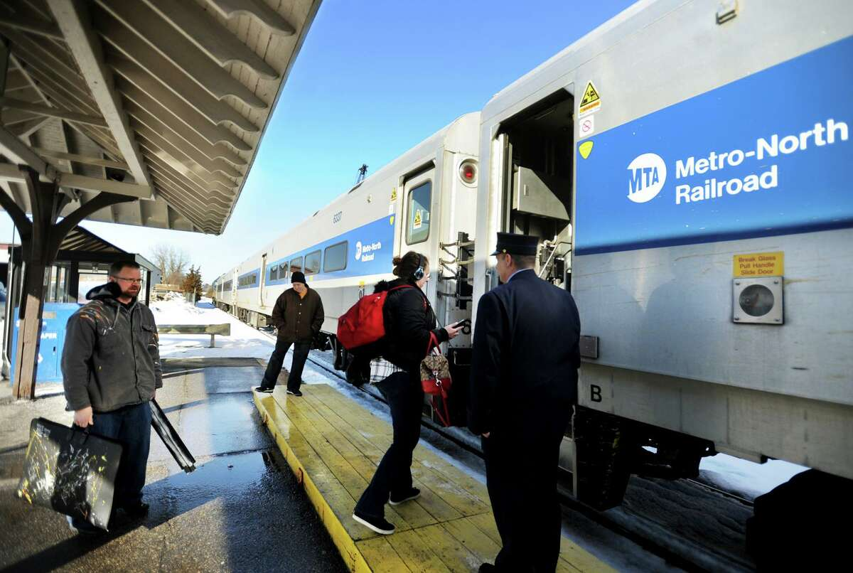 Riders board the 2:40 pm Bridgeport bound train on the Metro North Waterbury branch rail line at the Derby/Shelton station in Derby, Conn. on Tuesday, February 14, 2017.