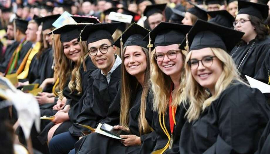 Ferris State University students pose during a previous commencement ceremony. On Saturday, nearly 1,000 students will graduate during two different ceremonies. (Courtesy photo)