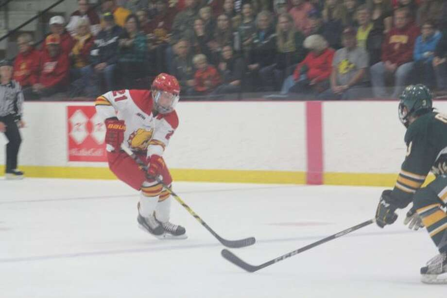 Corey Mackin (21) skates down the ice for Ferris in recent action. (Pioneer file photo)