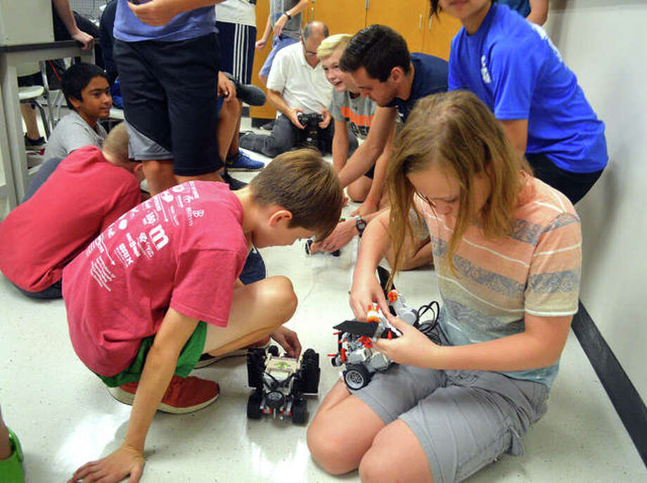 """Students built and programmed Lego robots for a tug of war contest as part of the """"Odyssey 5 — Geared Up"""" session during the Odyssey Science Camp. The camp, which runs from July 15-26, offers five different sessions for students entering grades 2-7, all with different scientific topics. Photo: Scott Marion 