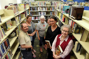 Members of the Ravena Coeymans Selkirk Community Library book club gather for a photos with Judith Wines, library director, second from right, on Tuesday, July 23, 2019, in Ravena, N.Y. The top three books checked out from the library were all read by their book club. (Will Waldron/Times Union)