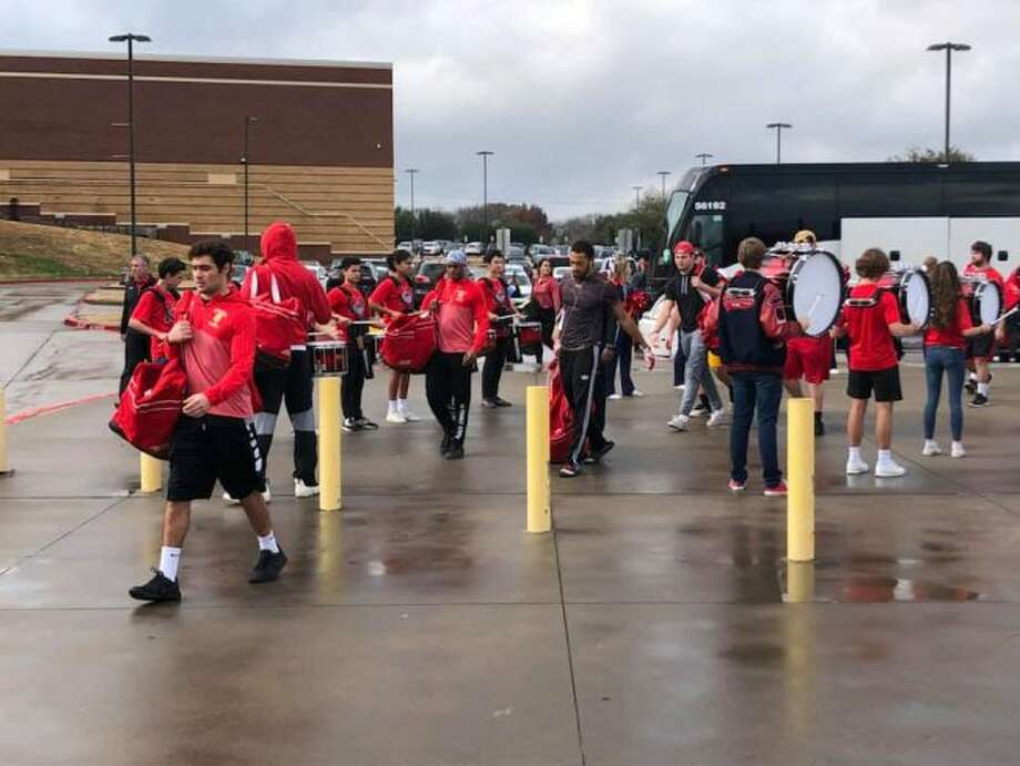 Members of the Ferris State University football team exit the buses that brought them to McKinney, Texas for the Division II National Championship game. On Sunday, community members can welcome the players home at 3:15 p.m. at the R.L. Ewigleben Sports Complex, 210 Sports Drive. (Courtesy photo/Ferris Athletics)