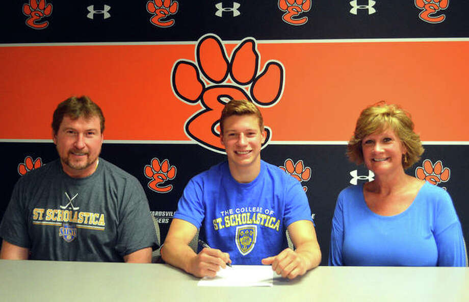 Former Edwardsville standout Tyler Hinterser, seated center with his parents, will play college hockey for St. Scholastica in Duluth, Minnesota. Photo: Scott Marion|The Intelligencer