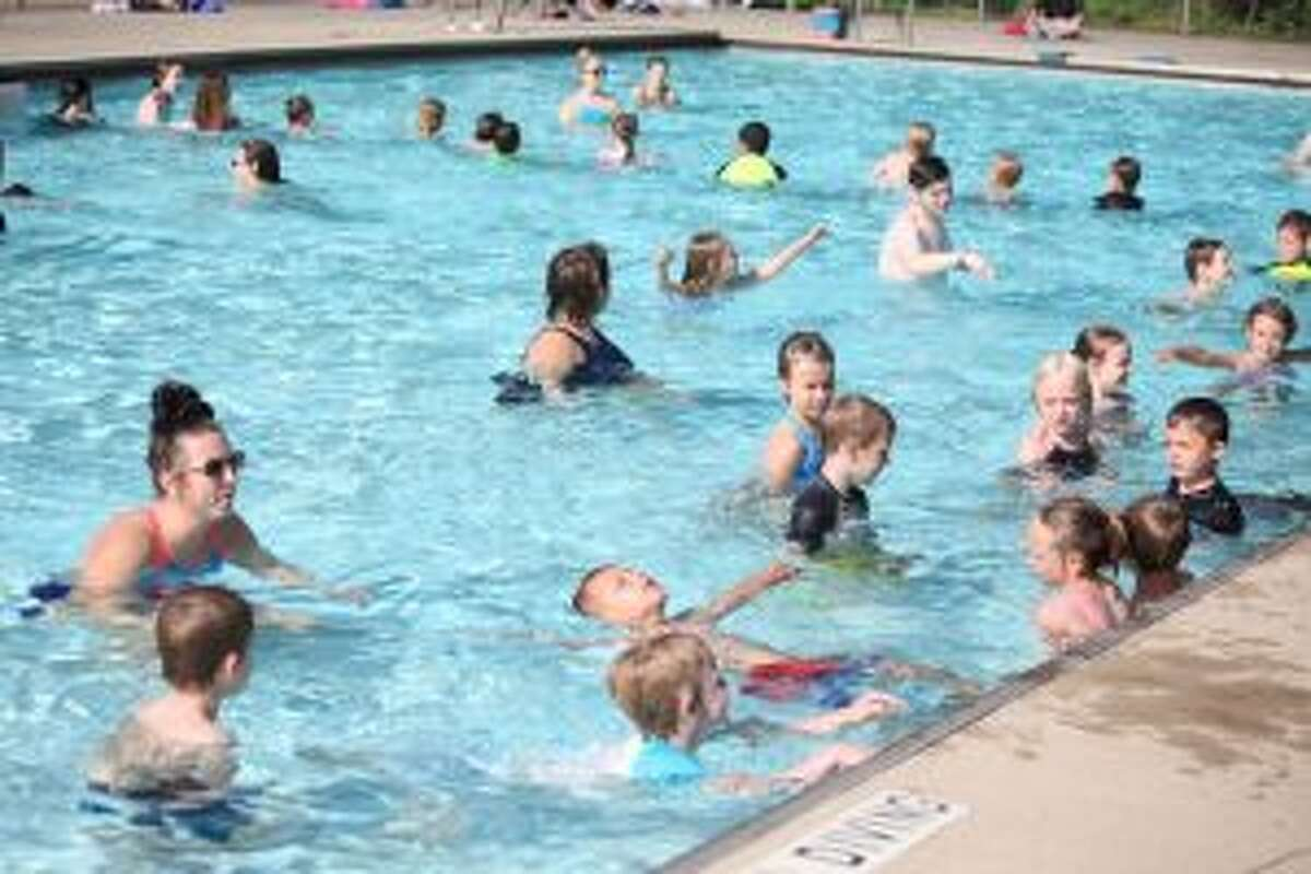 Kids taking beginners and advanced beginners swimming lessons at Charles E. Fairman Community Pool splashed, kicked and doggy paddled through the pool as they learned how to be safe in the water. (Pioneer file photo)