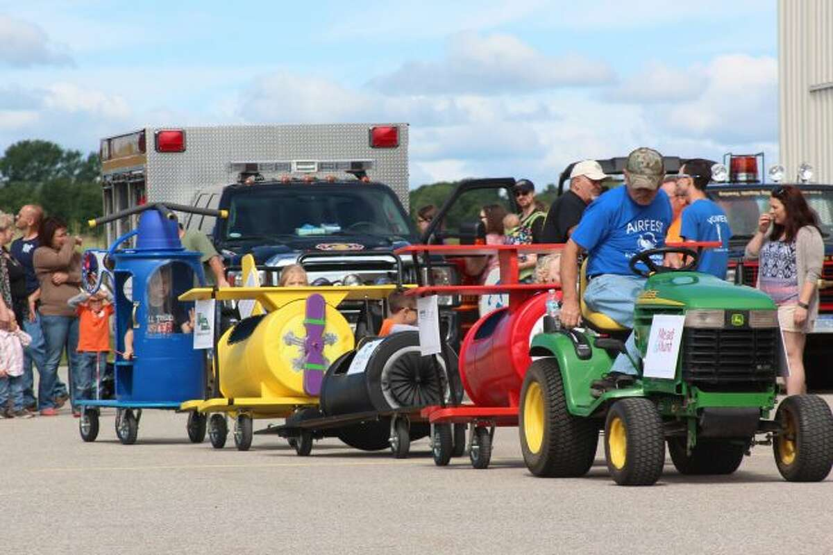Young passengers filled the airplane kiddie train ride along the tarmac during the 2017 Airfest at Roben-Hood Airport in Big Rapids. The kiddie train will be part of this year's low key event.(Pioneer file photo)