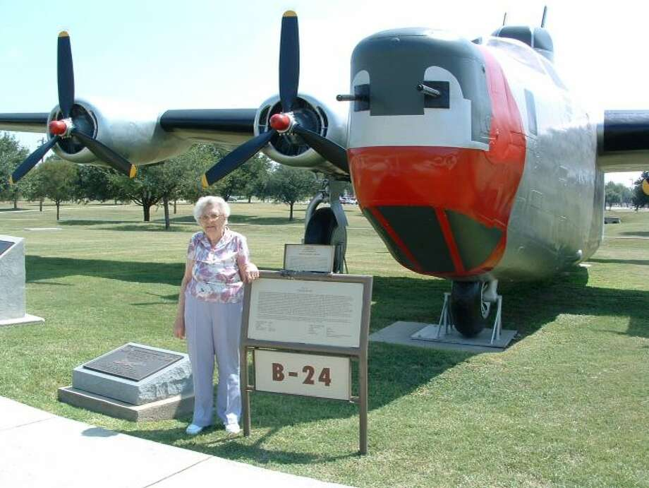 In 2008, Evelyn Dunn attended her grandson's U.S. Air Force Basic Training graduation at Lackland Air Force Base in San Antonio, Texas. She is pictured next to a B-24 Liberator on display. During World War II, Dunn was part of a two-person rivet team manufacturing B-24 wing assemblies. (Courtesy photo)