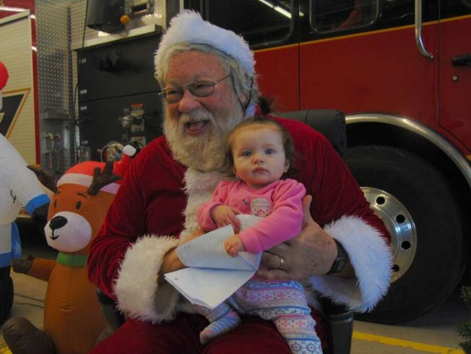 Maleigha Witte visits with Santa. (Pioneer photo/Shanna Avery)