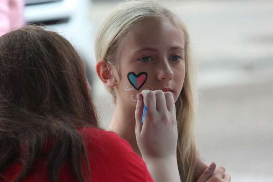 Lillian Davis, of Big Rapids, has a heart painted on her cheek during Saturday's Summerfest in downtown Big Rapids. (Pioneer photo/Brandon Fountain)