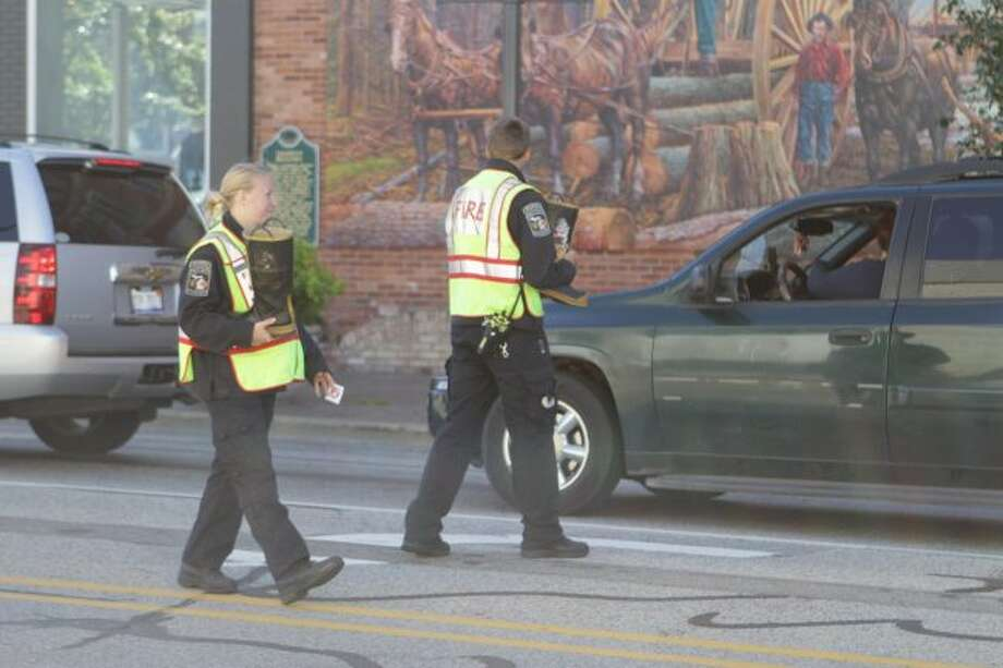 Firefighters with the Big Rapids Department of Public Safety will be downtown on Saturday, Sept. 28, with a fire boot collecting funds for the Muscular Dystrophy Association. (Pioneer file photo)