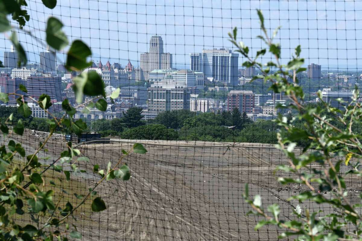 View of the Albany skyline seen across the S.A. Dunn Landfill viewed from Partition Street Extension on Friday, July 26, 2019, in Rensselaer, N.Y. (Will Waldron/Times Union)