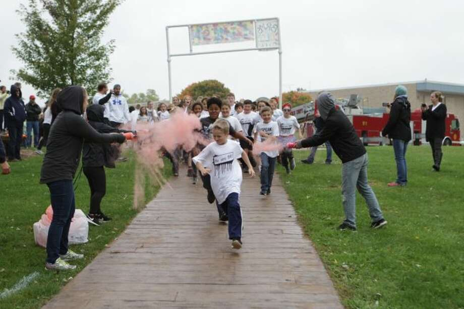 Students from last year's color run take off from the starting line. This year, the race will be held on Friday, Oct. 4. (Pioneer file photo)