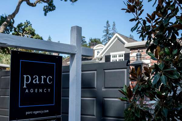 A home at 190 Almendral Avenue is seen with a For Sale sign posted outside the front gates in Atherton, Calif. Thursday, July 25, 2019.