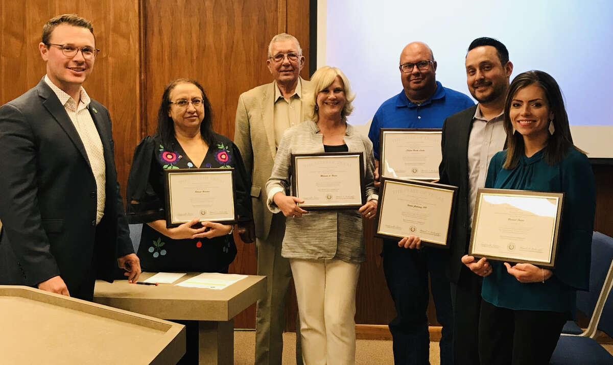From left: City Manager Jeffrey Snyder, City Secretary Belinda Hinojos, (back) Mayor Wendell Dunlap, Main Street Manager/Fair Theater Manager Melinda Brown, Landfill Foreman Brock Lively, Director of Technology Isauro Gutierrez and HR Director Rachel Foster