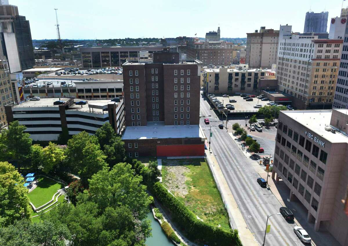 """This undeveloped patch of land at 151 East Travis in downtown San Antonio might be developed in to a boutique hotel. The site's location in an opportunity zone """"was a significant factor"""" for the developer when they bought the land earlier this year."""