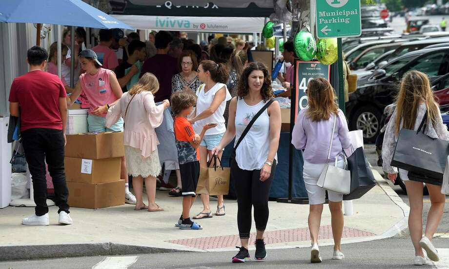 Shoppers hunt for bargains from local retailers as they stroll up and down Greenwich Avenue during Greenwich Chamber of Commerce Sidewalk Sales Day in Greenwich, Conn. on July 11, 2019. The biggest shopping event of the year, with over 100 stores participating in this event, super bargains can be found during this four day shopping extravaganza. Photo: Matthew Brown / Hearst Connecticut Media / Stamford Advocate