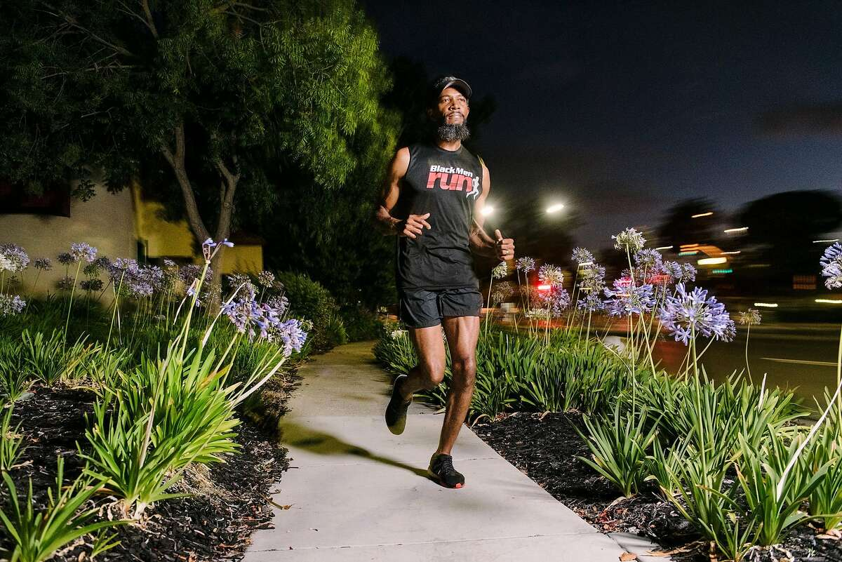 Kyrah Ayers takes an early morning run while training to run the half-marathon during the upcoming San Francisco Marathon, in Hercules, Calif., on July 25th, 2019. Kyrah is the president of the Bay Area chapter of Black Men Run, a group that promotes overall health and fitness, and focused on running.