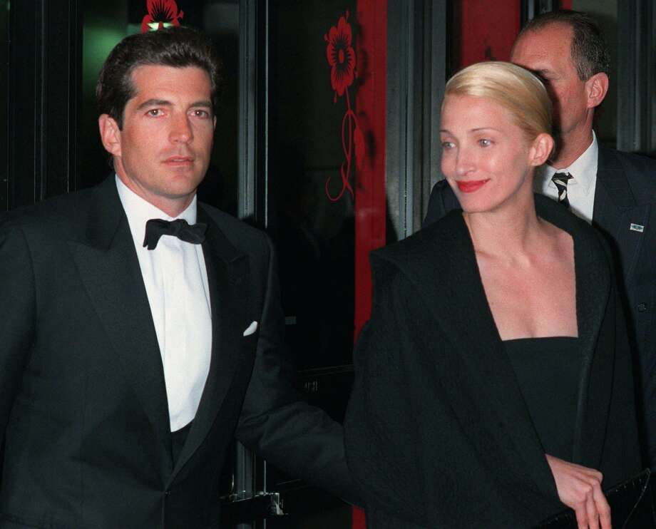 John F. Kennedy, Jr. and his wife, Carolyn Bessette Kennedy, arrive at the Minskoff Theatre in this, April 6, 1998 file photo. Kennedy and his wife, were having marital problems and were living apart when they died in an airplane crash in July 1999, a new book asserts. The August 2003 issue of Vanity Fair magazine contains excerpts from Edward Klein's new book, ``The Kennedy Curse,'' which assert that Kennedy and his wife differed on whether to have a family, on drug use, on Kennedy's outgoing lifestyle and on their TriBeCa apartment. (AP Photo/Mitch Jacobson, File) Photo: MITCH JACOBSON, STR / AP / AP
