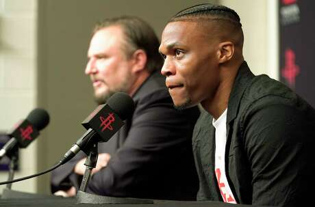Russell Westbrook talks to the media with Rockets General Manager Daryl Morey during a  press conference introducing him  at the Toyota Center on Friday, July 26, 2019 in Houston.