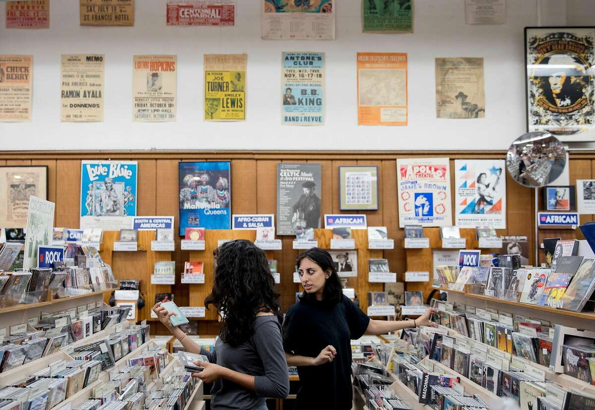 Saba Kahn (right) and Nehal Hanif of Pinole browse through CDs inside Down Home Music Store along San Pablo Avenue in El Cerrito, Calif. Tuesday, July 16, 2019.