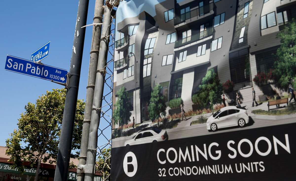 Advertisements for a new housing development in the early stages of construction are seen at the corner of Eureka and San Pablo avenues in El Cerrito, Calif. Tuesday, July 16, 2019.