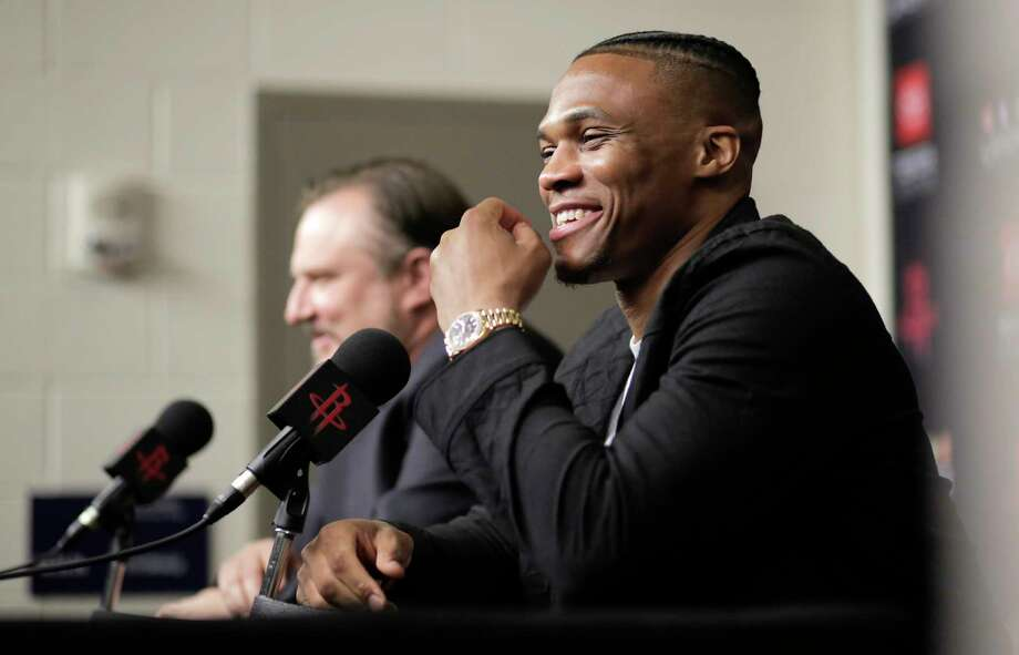 Russell Westbrook talks to the media with Rockets General Manager Daryl Morey during a  press conference introducing him  at the Toyota Center on Friday, July 26, 2019 in Houston. Photo: Elizabeth Conley, Staff Photographer / © 2018 Houston Chronicle